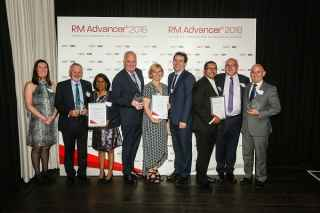 RM Advancer winners displaying their trophies